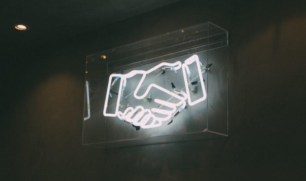 Handshake neon
